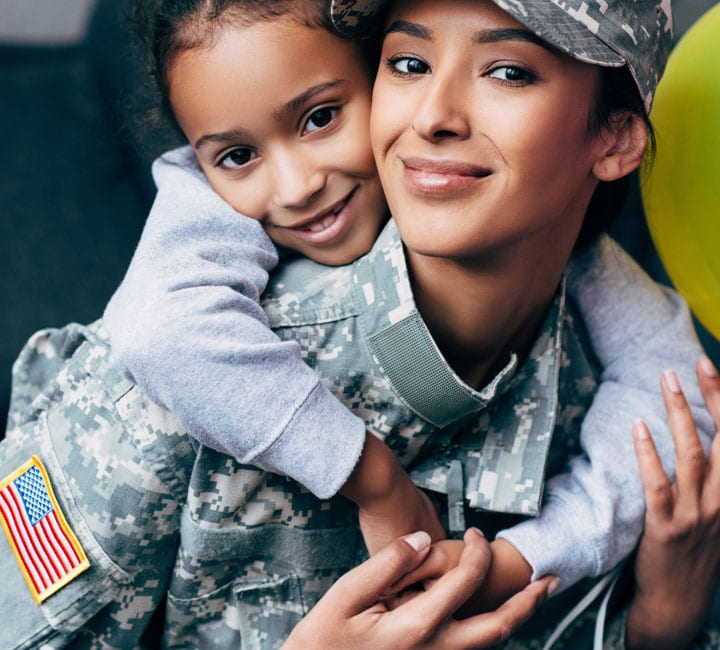 Daughter hugs her Mother who's in her US armed forces uniform